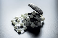 Jewellery box with white pearls with studio lights Stock Photo