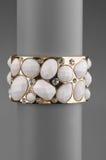 Jewellery bracelet. Beautiful fashion jewellery bracelet on gray background Stock Photography