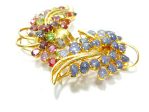 Jewellery brooches. On the background Royalty Free Stock Photo