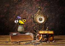 Jewellery, clocks and flowers Stock Photography