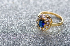 The jewellery concept with ring on shiny background Stock Photos
