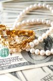 Jewellery with dollars Stock Image