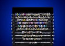Jewellery elements on showcase Stock Photos