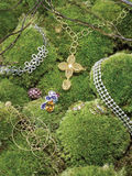 Jewellery on green foliage Royalty Free Stock Photography