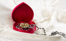 Jewellery in heart shaped box Stock Image