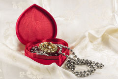 Jewellery in heart shaped box Stock Photo