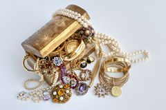 Jewellery In Treasure Chest With Rings, Precious Stones, Diamond And Bracelets Royalty Free Stock Images