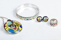 Jewellery. Pendant, bracelet, earrings, ring Stock Photos