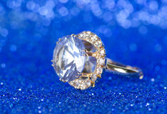 The jewellery ring against blue background Royalty Free Stock Image