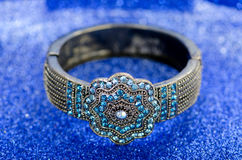 The jewellery ring against blue background Stock Photography