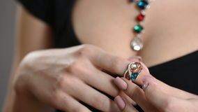 Jewellery ring worn on the finger. ring with colored stones stock footage