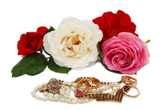 Jewellery and roses Stock Photography