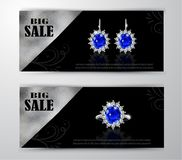 Golden earrings with sapphire and diamonds Royalty Free Stock Images