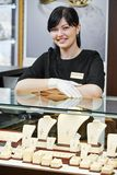 Jewellery shop sales assistant Stock Image