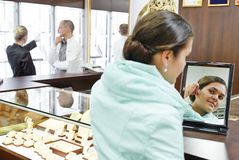 Jewellery shopping in boutique Royalty Free Stock Image