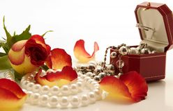 Jewelries. Set of jewelries and flowers over white background Stock Photos