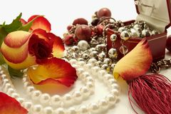 Jewelries. Set of jewelry and flower over white background Royalty Free Stock Photo