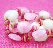 Jewelry. Some beautiufl pink jewelry on a pink background Royalty Free Stock Photo