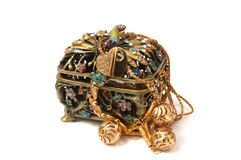 Jewelry. Beautiful metal box with gold jewelry in it Royalty Free Stock Photo