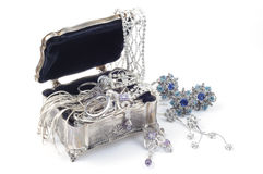 Jewelry. Metal box open with  jewelry, on white Stock Images