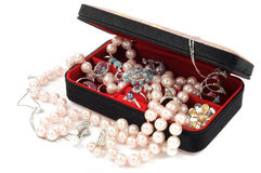 Jewelry. Open jewelry box full of accessory, on white background Royalty Free Stock Images