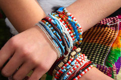 Jewelry. Beads over crossed wrist Stock Image