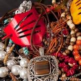 Jewelry. Pile of Jewelry on black background Stock Photo