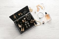 Jewelry accessories in box and table. Top view Royalty Free Stock Image