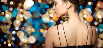 Close up of beautiful woman face with earring Stock Photography