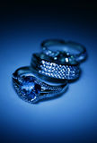 Jewelry accessories  rings in blue light Royalty Free Stock Photo