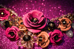Jewelry background with luxury flowers on pink glitter Royalty Free Stock Image