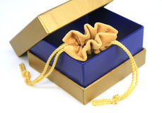 Jewelry bag in gold box Royalty Free Stock Photos