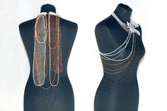 Jewelry from beads. On a figure royalty free stock images