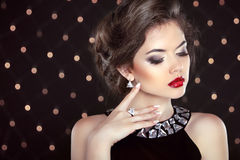 Jewelry. Beautiful brunette young woman. Fashion girl model over Stock Photos