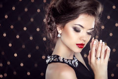 Jewelry. Beautiful brunette young woman. Fashion girl model over Stock Photography