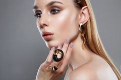 Jewelry on beautiful girl. woman with make-up and jewels stock images