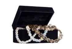 Jewelry in a black velvet box Stock Photography