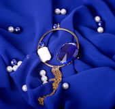 jewelry on blue background Royalty Free Stock Photography