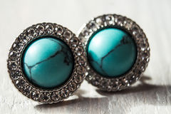 Jewelry blue earrings with shiny stones Royalty Free Stock Photo