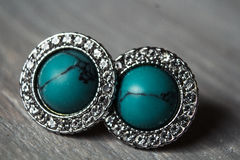 Jewelry blue earrings with shiny stones Royalty Free Stock Images