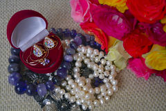 Jewelry and a bouquet in honor of the event. The jewelry and a bouquet of flowers in honor of the event Royalty Free Stock Photos