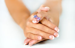 Jewelry bow on a female finger Royalty Free Stock Photos