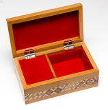 Jewelry box. Musical jewelry box with red interior on white background Stock Photo