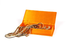 Jewelry Box. Orange jewelry box isolated on a white background Royalty Free Stock Photography