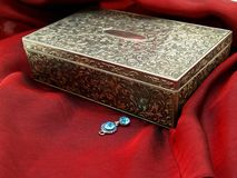 Jewelry box. Earring next to a jewelry box stock images
