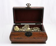 Jewelry box. Open jewelry box with gold coins Royalty Free Stock Images