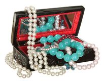 Jewelry box with beads, pearls and jewellery isolated on white background. Royalty Free Stock Images