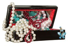 Jewelry box with beads, pearls and jewellery isolated on white background. Royalty Free Stock Image