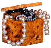 Jewelry box with beads, pearls and jewellery isolated on white background. Stock Photo
