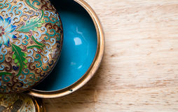 Jewelry box. Closeup photo of a beautiful vintage jewelry box on a wooden table Royalty Free Stock Photo